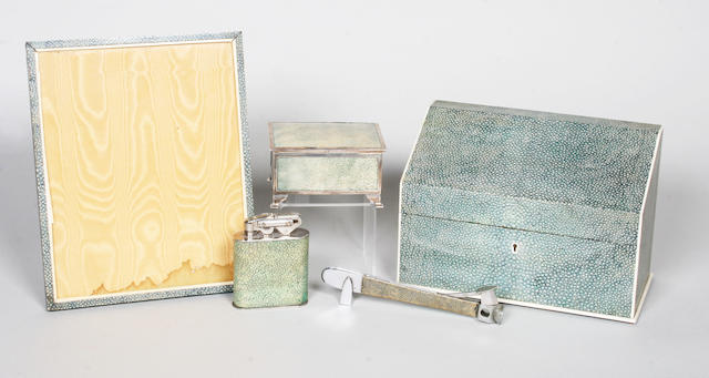 An early 20th century composite five piece green shagreen and ivory mounted desk set