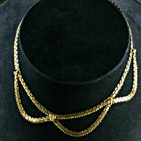 A brick-link chain necklace,