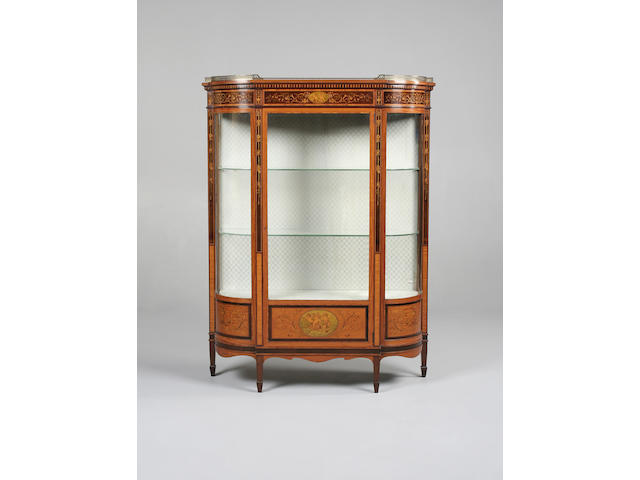 An Edwardian satinwood, sycamore and marquetry display cabinet