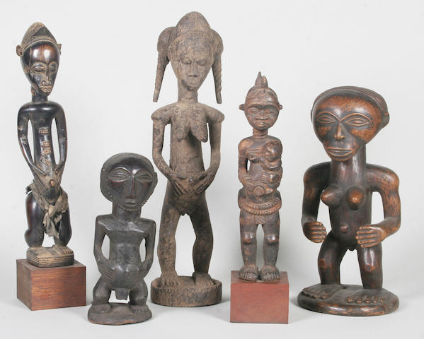 A group of decorative African carved wood tribal figure sculptures