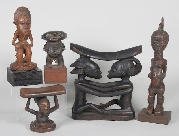 A group of decorative carved wood African tribal figure sculptures