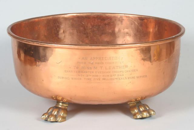 A large oval copper jardiniere