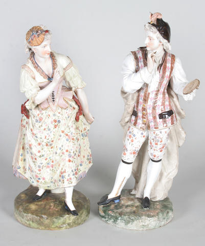 A pair of continental porcelain figures Late 19th Century,
