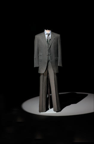 A Brioni grey three piece-suit, from Goldeneye 1996 as worn by Pierce Brosnan,