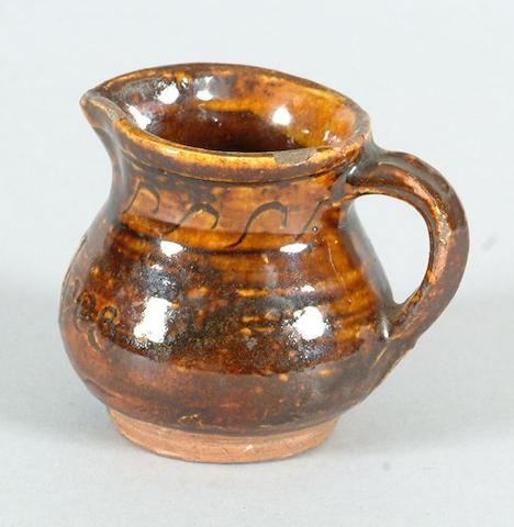 The Leach Pottery a miniature Jug, 1927 Height 6.5cm (2 1/2in.)