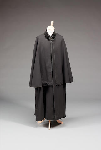 A Black victorian cape/coat from the Sherlock Holmes television series as worn by Jeremy Brett,
