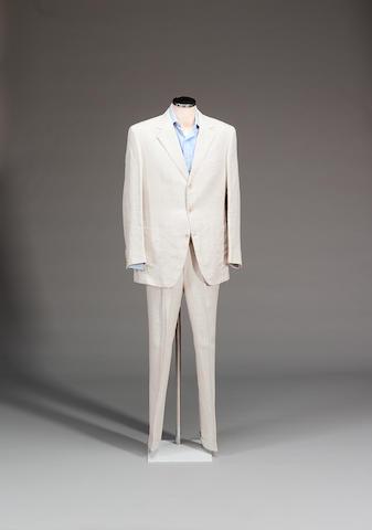 Pierce Brosnan from Goldeneye, 1995 A cream linen Brioni suit and Turnbull & Asser sea island blue cotton shirt,