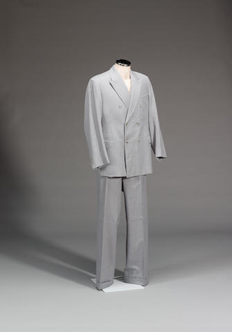 A pair of over pants and a grey suit, from Superman, as worn by Christopher Reeve,