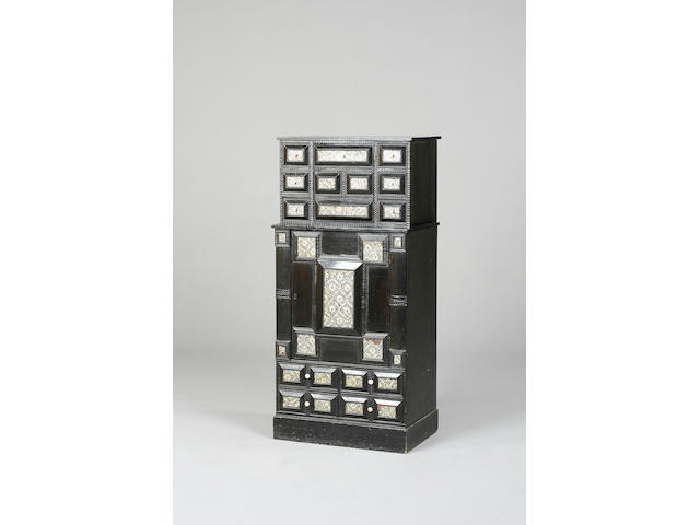 A 19th century Indo-Dutch ebony and mother of pearl inlaid cabinet