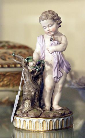 A Meissen figure of a cherub,