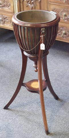 An Edwardian mahogany and boxwood strung jardiniere stand