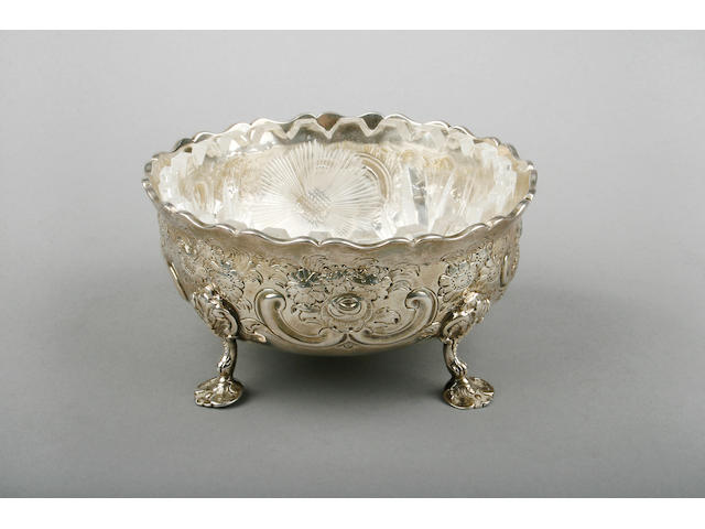 An early Victorian silver embossed sugar bowl, 'DH CH' within a quatrefoil, London, 1852,