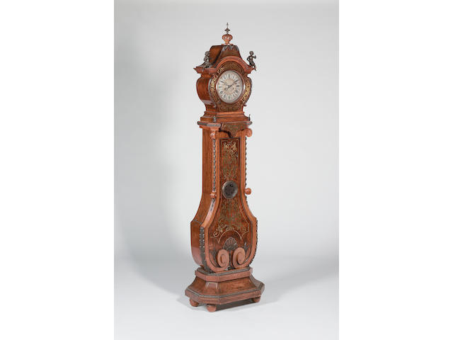 A late 19th century brass inlaid walnut longcase clock The movement signed Gustav Becker