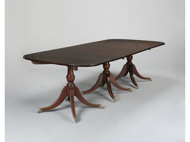 A George III style mahogany three pedestal extending dining table