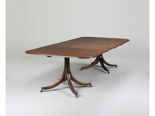 A Regency style mahogany extending dining table