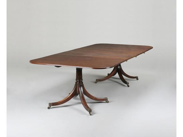A Regency style mahogany extending dining table