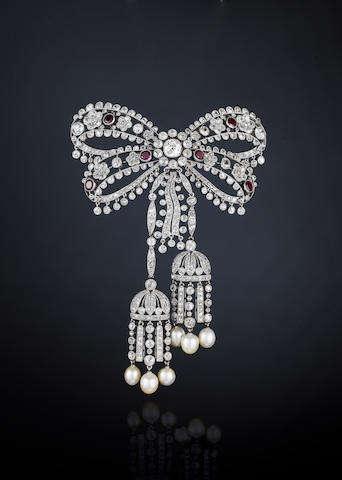 A fine Garland Style diamond, ruby and pearl devant de corsage, by Cartier****,