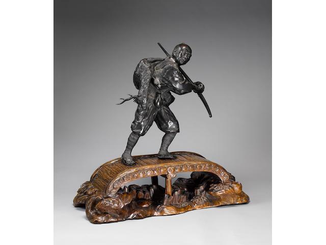 An impressive Tokyo School bronze okimono of a hunter,