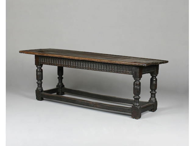A 17th century and later English carved oak refectory table