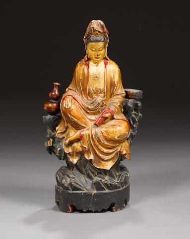 A gilt-lacquered wood figure of Guanyin 16th century