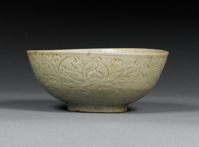 A celadon-glazed carved bowl 15th Century