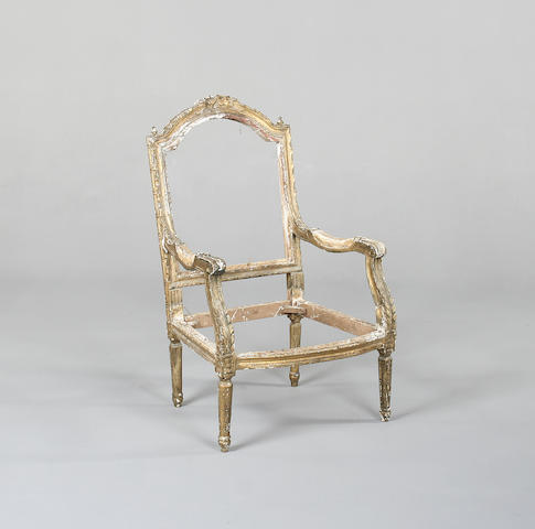 A Louis XVI style giltwood and composition carcasse of a fauteuil