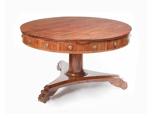 A William IV or early Victorian mahogany drum table,
