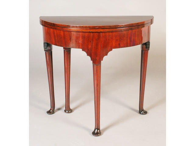 A George III mahogany demi-lune tea table,
