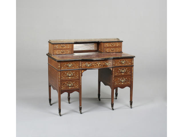 An Edwardian rosewood and marquetry writing desk