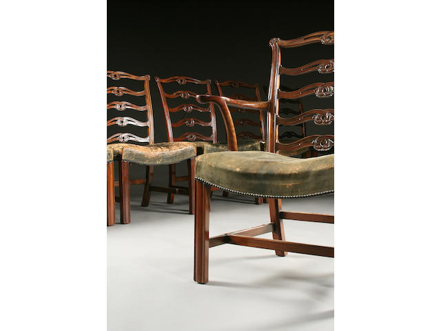 A set of twelve Edwardian mahogany dining chairs, in the George III style