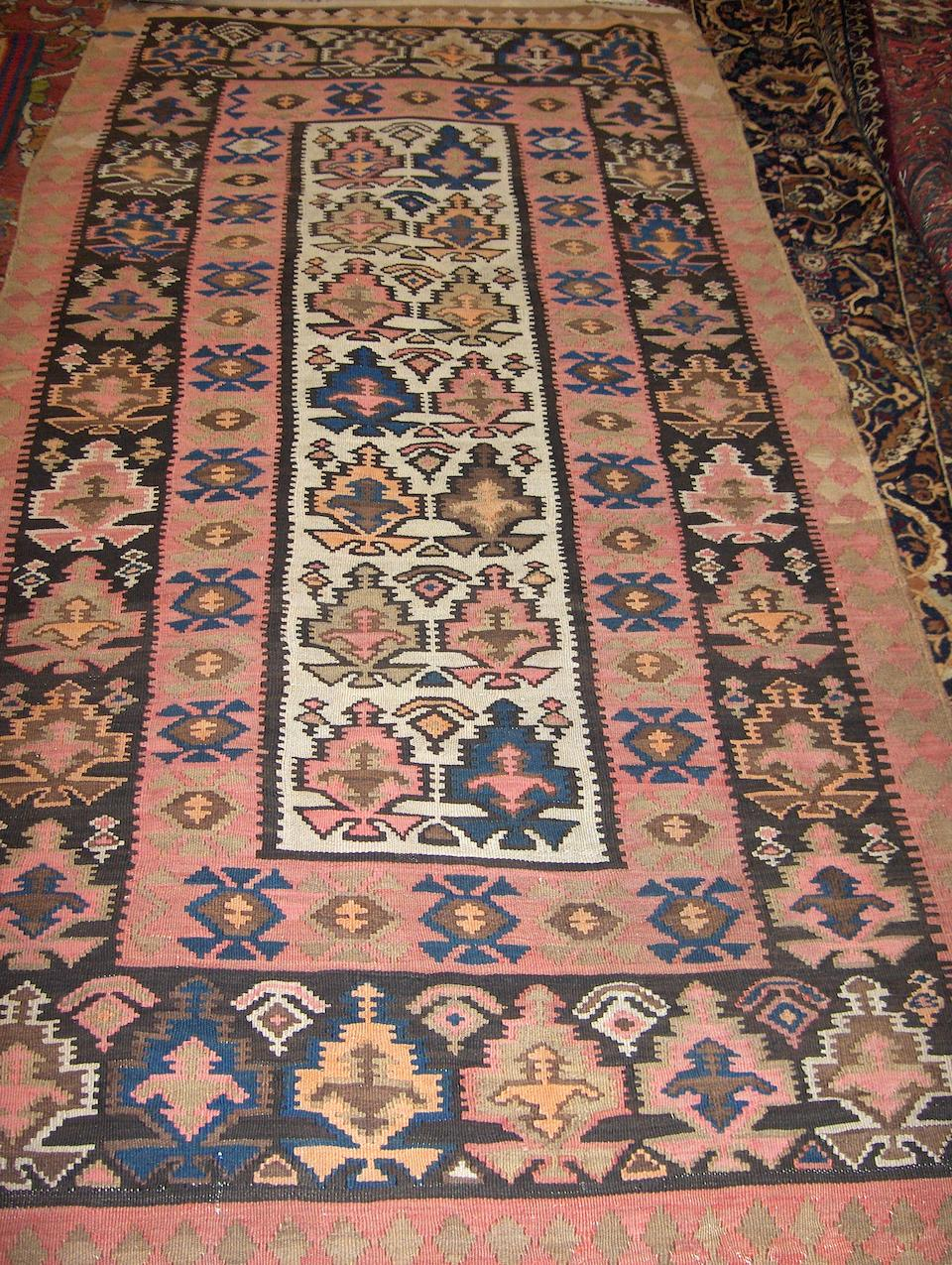 A North West Persian kilim 258cm x 133cm together with another kilim (2)