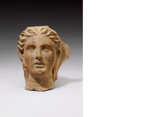 A South Italian terracotta female head