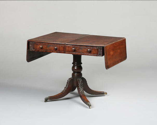 A late Regency mahogany and rosewood crossbanded sofa table