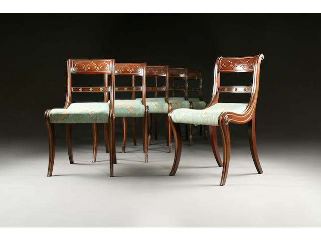 A set of eight c19th french dining chairs with sabre legs stamped TR