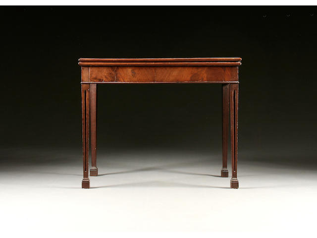 A mid George III mahogany fold over tea table,