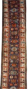 A North West Persian runner 20 ft x 3 ft 6 in (610 x 107 cm)