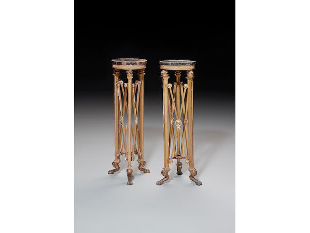 A pair of Regency giltwood Torcheres in the manner of Thomas Hope