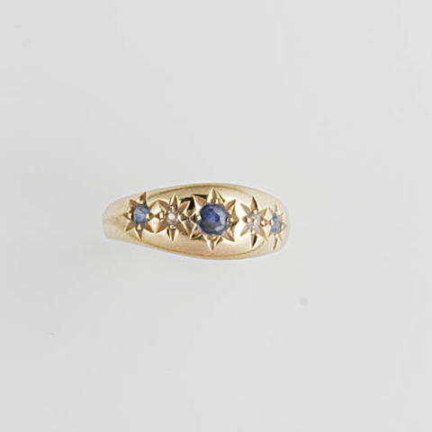 An 18ct gold gypsy set five stone sapphire and diamond ring (3)