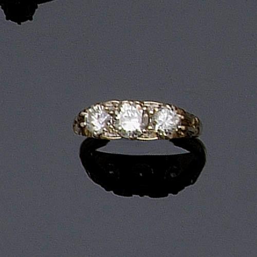 An 18ct gold diamond three stone ring