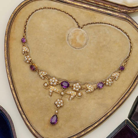 An Edwardian amethyst and half pearl necklace