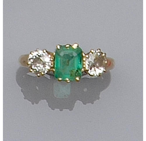 A diamond and emerald three stone ring