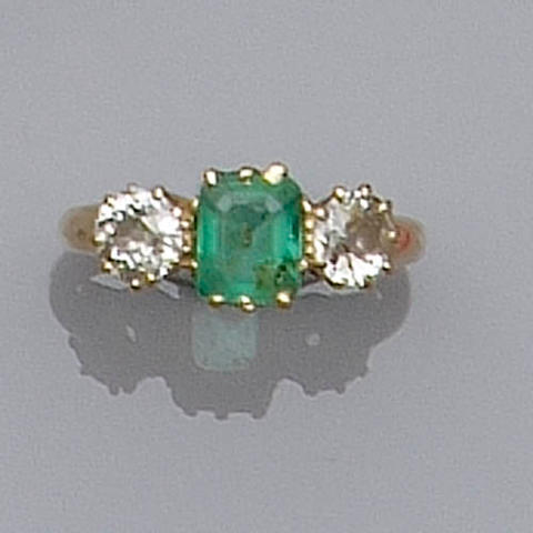 A diamond and emerald three stone ring