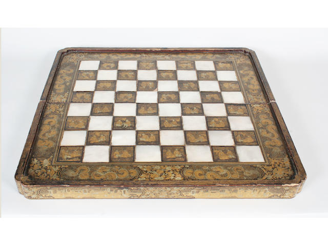 An early 19th century Chinese export lacquered games board/box,