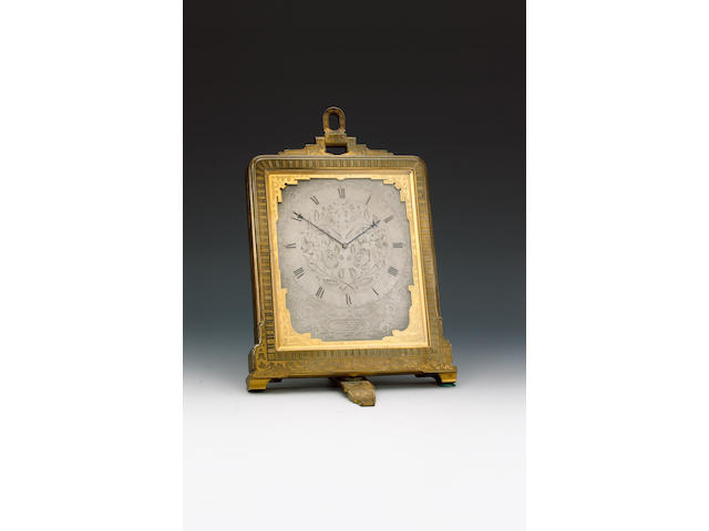 A mid 19th century engraved brass carriage clock  in travelling case Retailed by London and Ryder, attributed to Thomas Cole.
