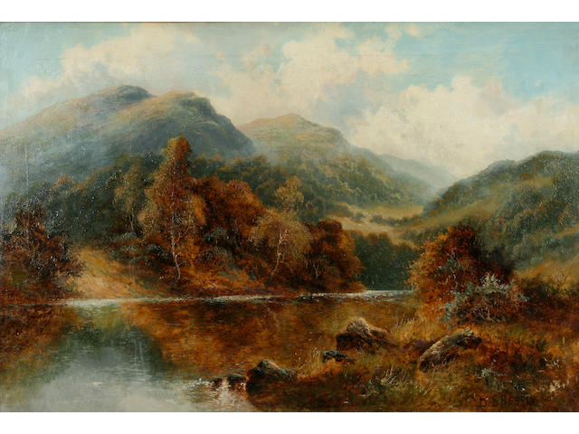 Daniel Sherrin (British, 1868-1940) An autumn landscape with lake and mountains,