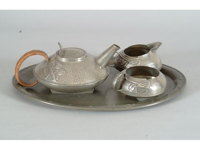 A Liberty & Co Tudric three piece tea set Archibald Knox design, numbered 0231, RD No 420290, English Pewter and Solkets mark,  (4)