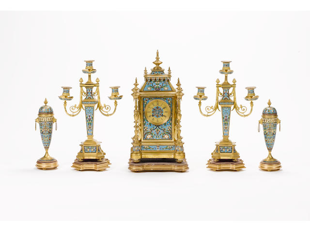 A late 19th century French champleve enamel decorated clock garniture Retailed by E.W. Streeter, 37 Conduit St. London