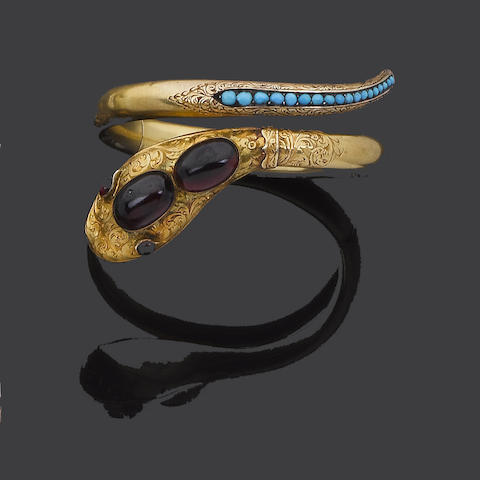 A mid 19th century gold, garnet and turquoise snake bangle,