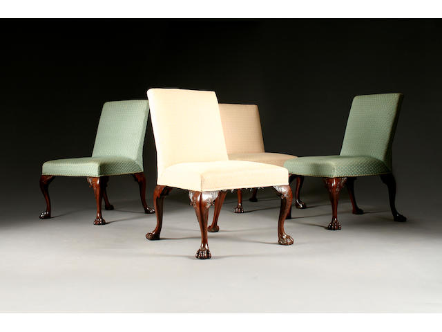 A set of four George II upholstered mahogany side chairs