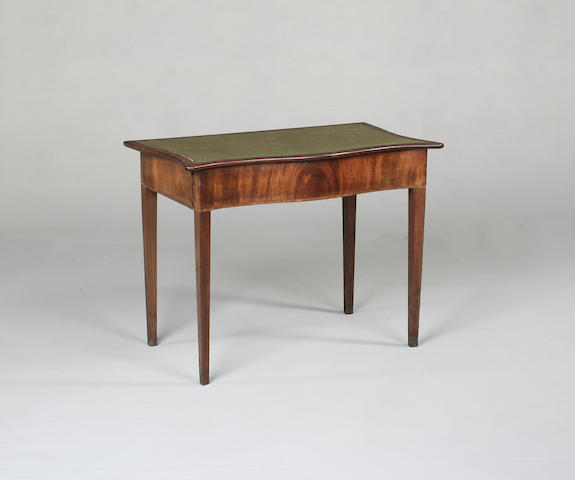 A George III mahogany serpentine side table